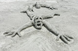 sand sculpture of a crawling man poster