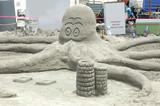 sand octopus sculpture poster