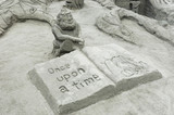sand sculpture of a book poster