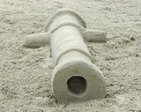 sand sculpture of a cannon poster