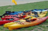 kayaks on shore poster