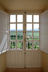 view through wooden doors to countryside