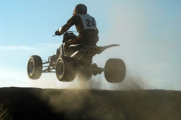 jumping with a quad during a race