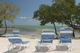 white sand blue chairs
