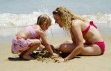 mother and daughter at the beach poster