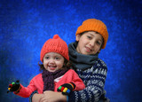 brother and sister having fun in winter poster