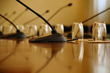 microphones in empty conference hall poster