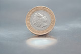 two pounds coin over silver plate poster