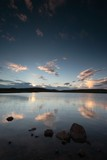 sunset reflected in remote loch in scotland poster