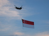 copter flying singapore flag poster