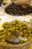 olives on display in a french market poster
