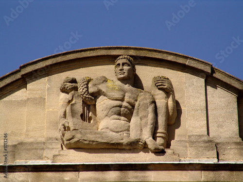 stone man guardian on art-deco palace