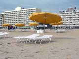 beach umbrellas and  lounge chairs at va beach poster