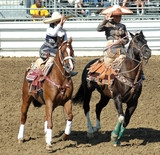 two mexican cowgirls on horseback poster