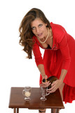 woman in red dress pouring drinks poster
