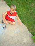 boy sitting on ground poster