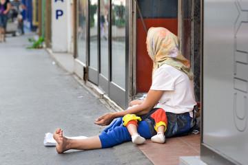 woman beggar asking for money in skopje, macedonia