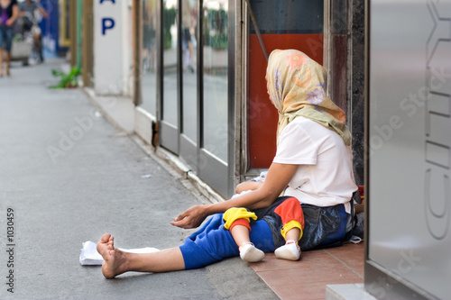 woman beggar asking for money in skopje, macedonia