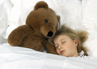sleeping girl with big teddy bear