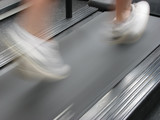 man running on treadmill poster