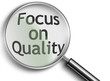 magnifying glass with focus on quality