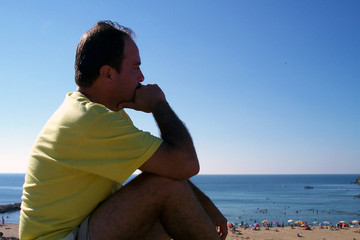 man thinking over the beach