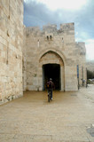 bicyclist entering jaffa gate, jerusalem