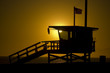 lifeguard tower at sunset with american flag