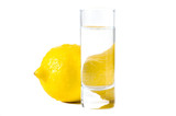 isolated lemon behind the glass of water on white poster