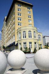 hotel with three large sphere sculptures in foregr