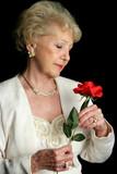 elegant senior holds rose poster