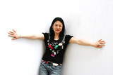portrait of a korean woman in jeans and a t-shirt poster