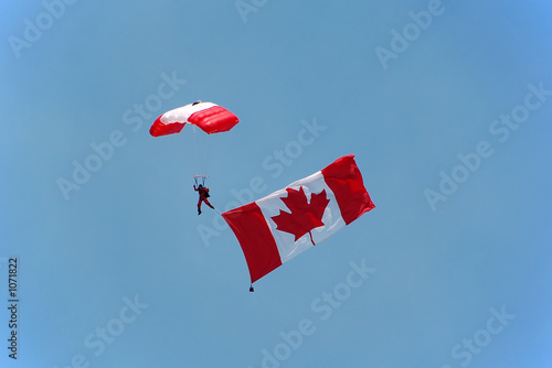canadian parachutist with flag