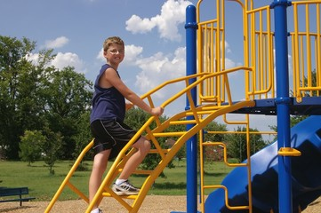 boy and playground equipment