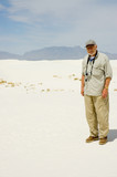 elderly man in the dunes poster