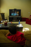 boy watching television poster
