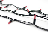 row of holiday lights with shallow depth of field poster