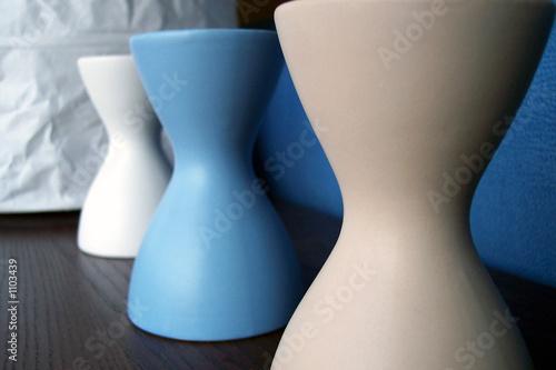 three colored vases