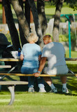 old couple eating lunch outside poster