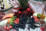dessert table with fruit and cake poster