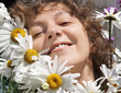 smiling woman with daisies