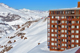 Hotel on snowy mountainside poster