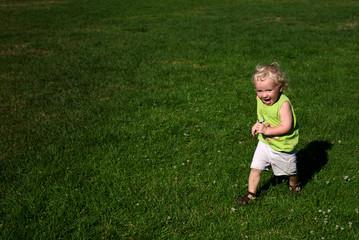 boy running on lush, green grass