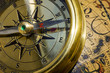 old style gold compass & globe closeup
