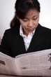 asian businesswoman reading
