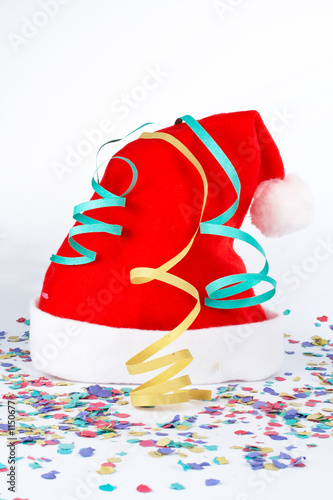 christmas hat with ribbons and confetti