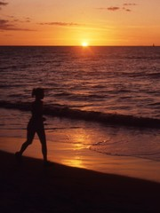 woman running at sunset