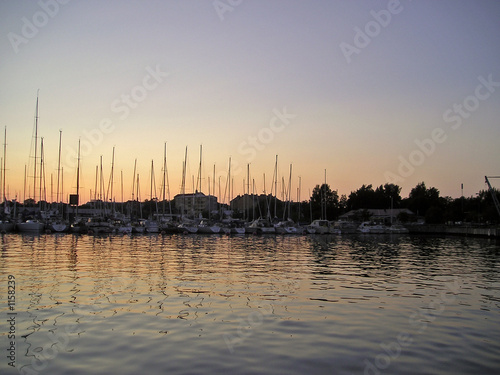Aluminium Poort sun setting at a marina