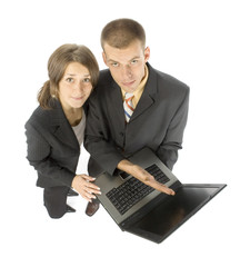 business couple shows laptop's screen