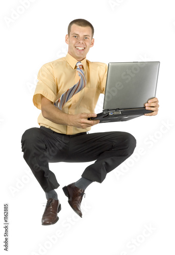 jumping  businessman with laptop